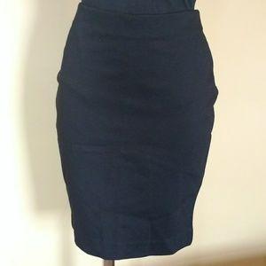 High-waist, stretchy pencil skirt with zipper.